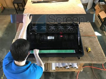 Outdoor wall mount touch screen kiosk testing