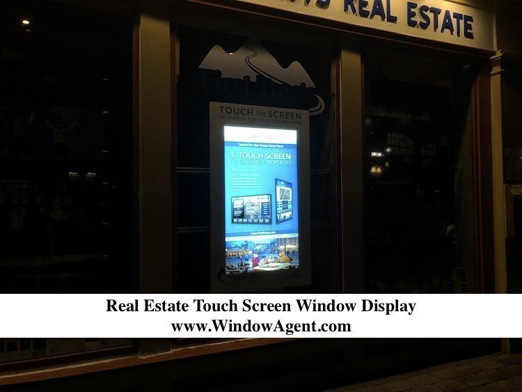 Real Estate Window Display at Night