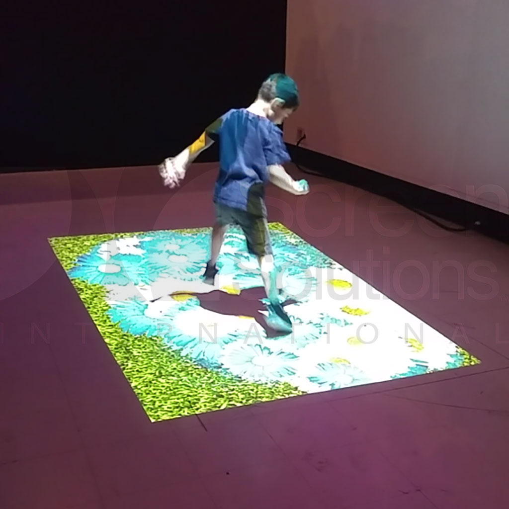 Child Playing with Interactive Projection Floor