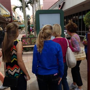 Mall Outdoor Kiosk with People Interacting